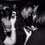 That's my pouf of hair just to the right of Bono as he signs my U2 paraphernalia. The next photo is the one visible in the iPhone. (Photo: Allen Cueli)